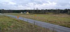 Ungefär vid vägskylten kommer det att byggas ett bostadshus.